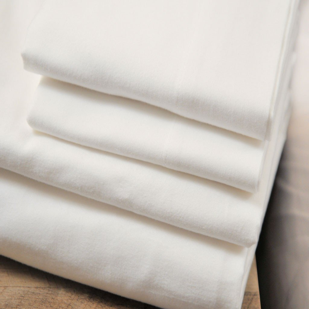 White Organic bedding stacked